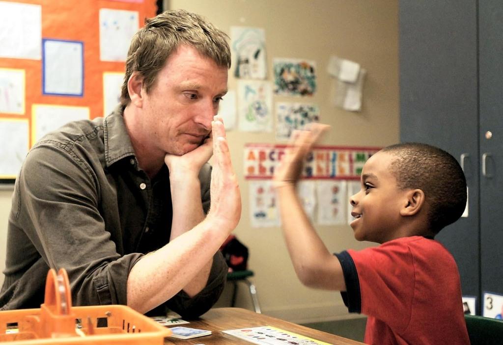 kindergarten teacher and student
