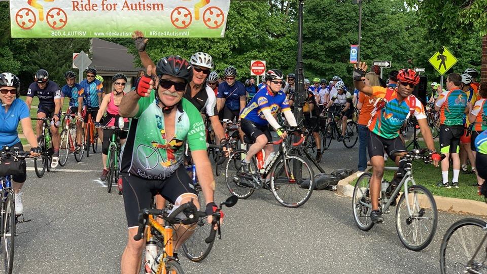 riders waving at start line
